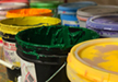 Buckets of our stock ink colors for screen printing.